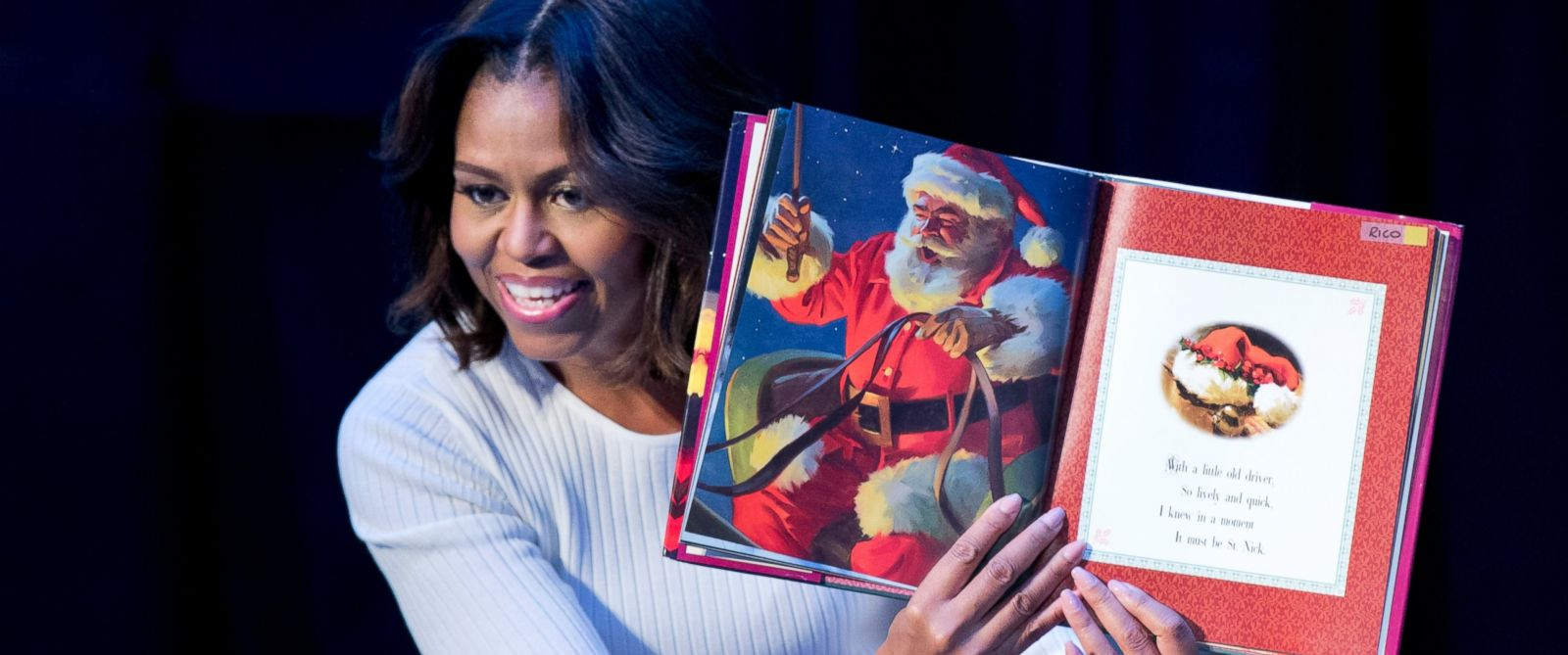 "PHOTO: First lady Michelle Obama reads ""Twas the night before Christmas""? to patients, families, and staff at Childrens National Health System in Washington, Dec. 15, 2014."