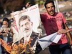 PHOTO: Egyptians against ousted President Mohammed Morsi burn his poster