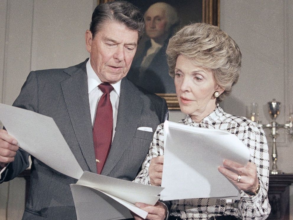 PHOTO:Ronald Reagan and Mrs. Nancy Reagan go over their joint address which they will give to the nation, at the White House in Washington, Sept. 13, 1986. The address will focus on the war against drug abuse.