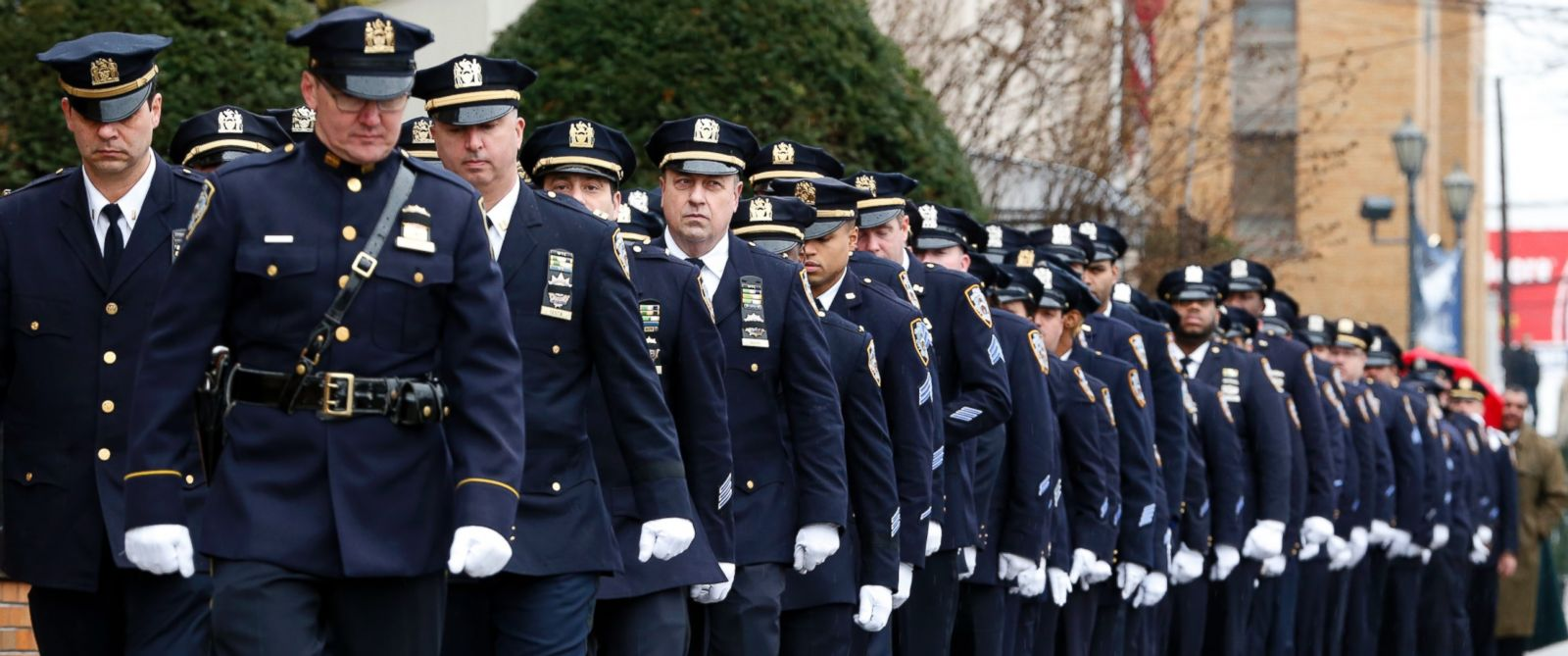 PHOTO: New York City police officers march before funeral services for police officer Wenjian Liu at Aievoli Funeral Home, Jan. 4, 2015, in the Brooklyn borough of New York.