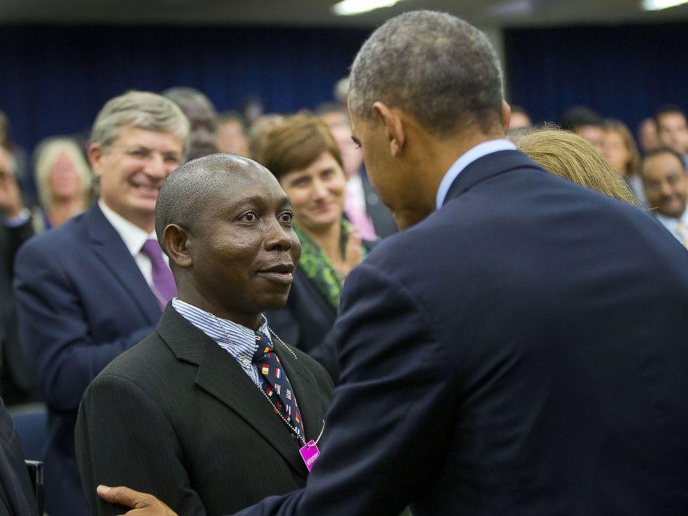 PHOTO: President Barack Obama, right, greets Dr. Melvin Korkor, left, after speaking at the Global Health Security Agenda Summit on Sept. 26, 2014 in Washington, D.C.