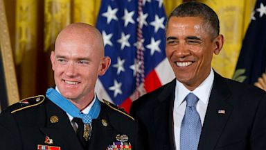 PHOTO: President Barack Obama stands with US Army Staff Sgt. Ty M. Carter after awarding him the Medal of Honor for conspicuous gallantry, Aug. 26, 2013, during a ceremony in the East Room of the White House in Washington.