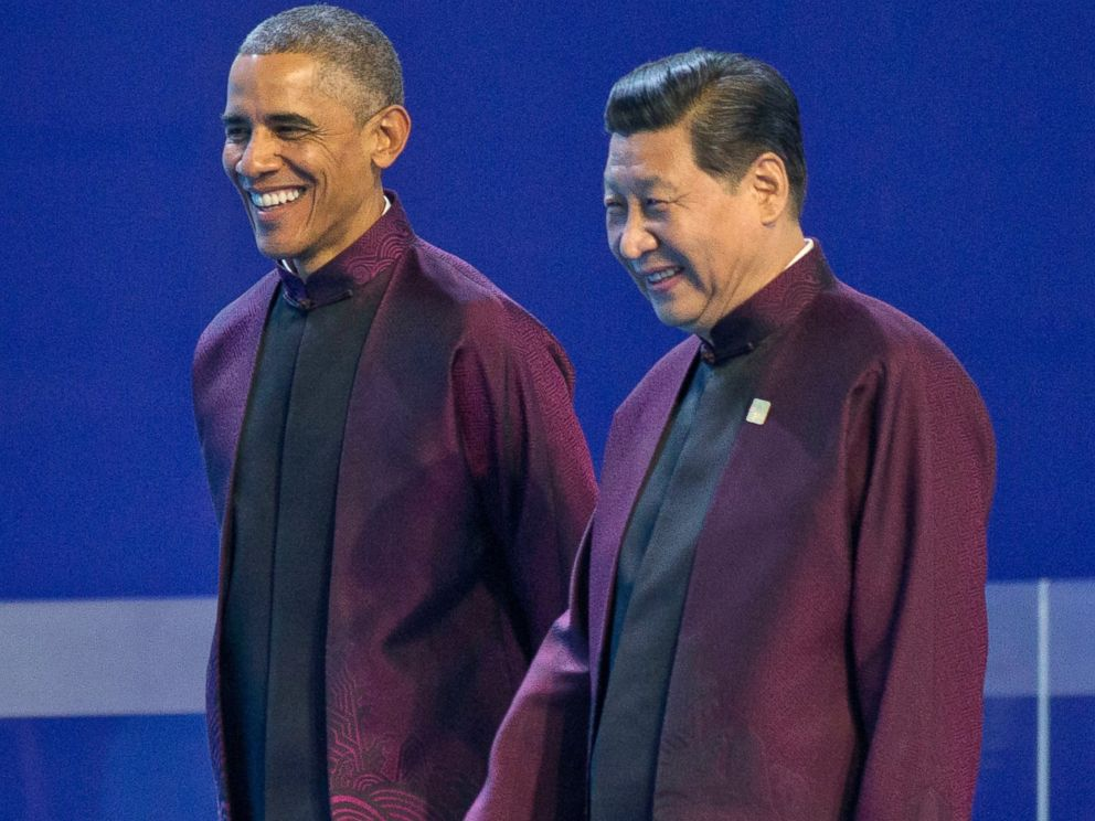 PHOTO: U.S. President Barack Obama, left, and Chinese President Xi Jinping walk during the Asia-Pacific Economic Cooperation (APEC) Summit family photo, Nov. 10, 2014 in Beijing.