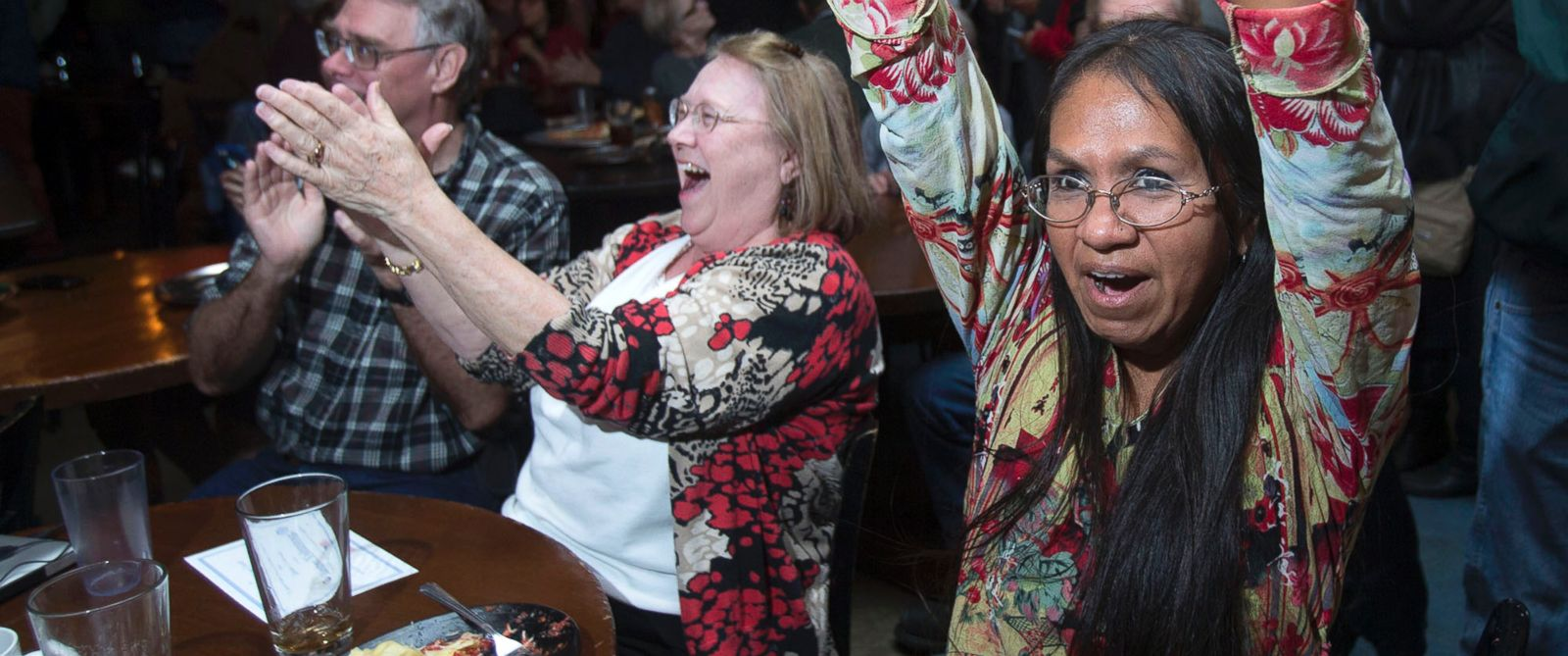 PHOTO: Sandra Shotridge, right, celebrates along with Zenia Liebman, center and Kevin Kidwell in Eugene, Ore., Nov. 4, 2014, as it is announced Measure 91 legalizing recreational marijuana was approved by voters.