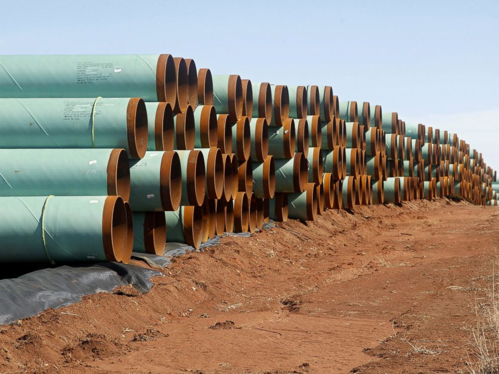 PHOTO: Miles of pipe for the stalled Canada-to-Texas Keystone XL pipeline are stacked in a field near Ripley, Okla.
