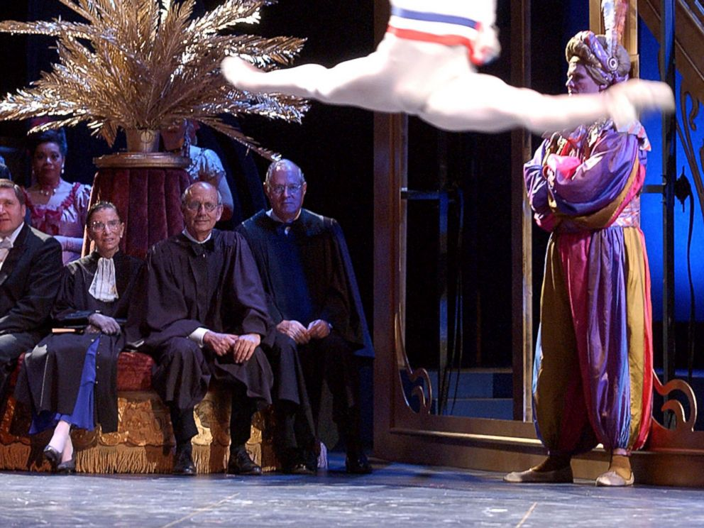 PHOTO: U.S. Supreme Court Justices Ruth Bader Ginsburg, Stephen Breyer, center, and Anthony M. Kennedy watch a ballet dancer as they play the roles of themselves in the Washington Operas production of Die Fledermaus in Washington, Sept. 6, 2003.