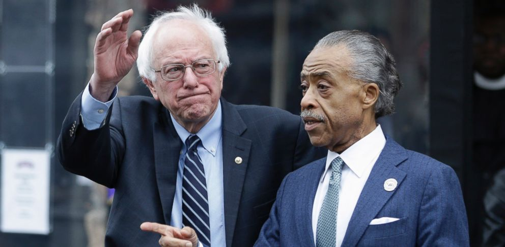 PHOTO: Democratic presidential candidate Sen. Bernie Sanders, left, waves to media and supporters after a breakfast meeting with Rev. Al Sharpton at Sylvias Restaurant, Feb. 10, 2016, in New York.