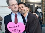PHOTO: John Lewis, left, and Stuart Gaffney embrace outside San Franciscos City Hall shortly before the U.S. Supreme Court ruling cleared the way for same-sex marriage in California, June 26, 2013.
