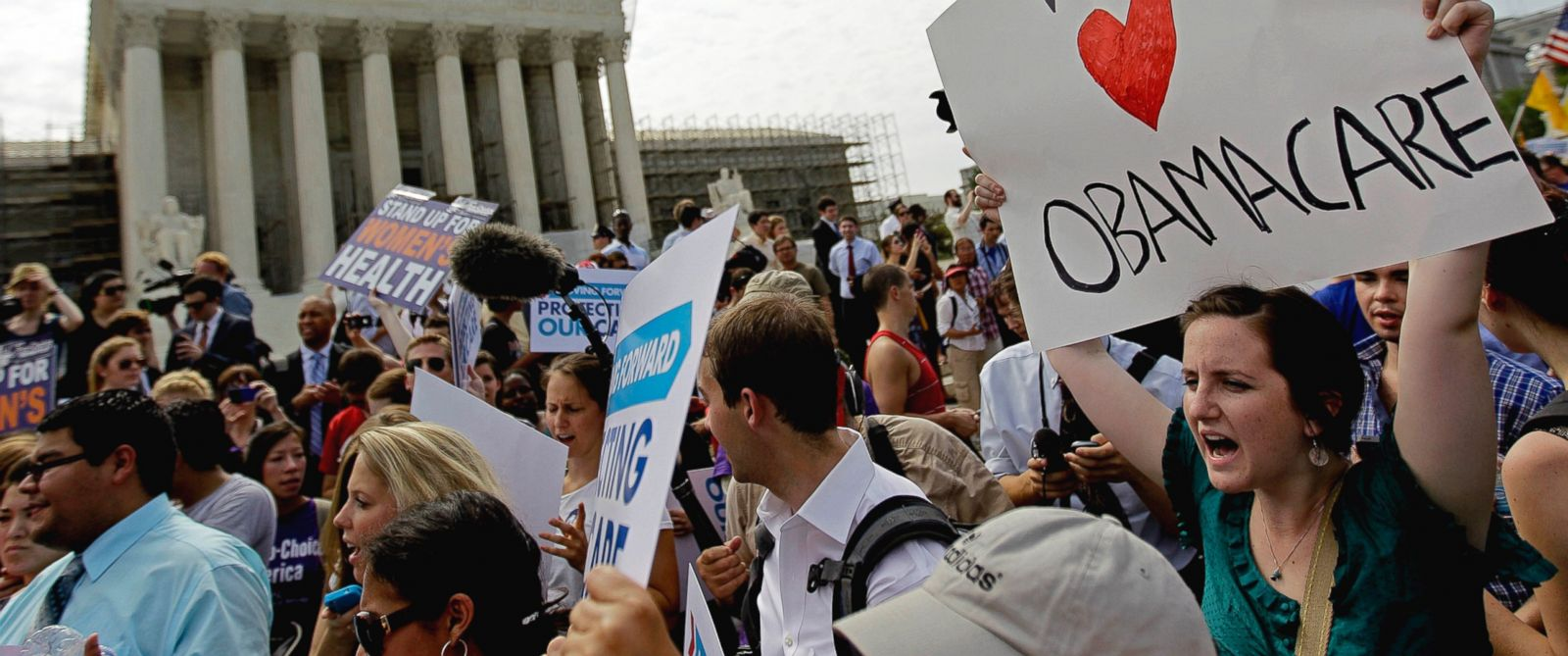 PHOTO: Supporters of President Barack Obamas health care law celebrate outside the Supreme Court in Washington, Thursday, June 28, 2012, after the courts ruling was announced.