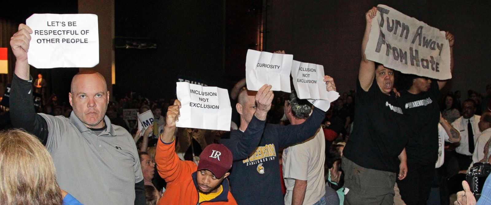 PHOTO: Protesters hold up signs as Republican presidential candidate Donald Trump speaks at a rally at Lenoir-Rhyne University in Hickory, N.C., March 14, 2016.