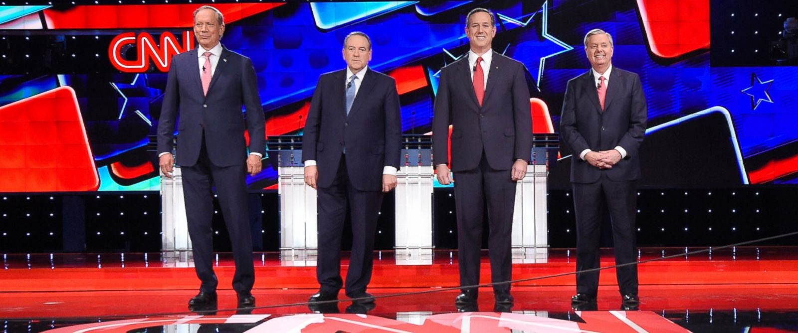 PHOTO: Republican presidential candidates, from left, George Pataki, Mike Huckabee, Rick Santorum, and Lindsey Graham take the stage during the CNN Republican presidential debate at the Venetian Hotel & Casino, Dec. 15, 2015, in Las Vegas.