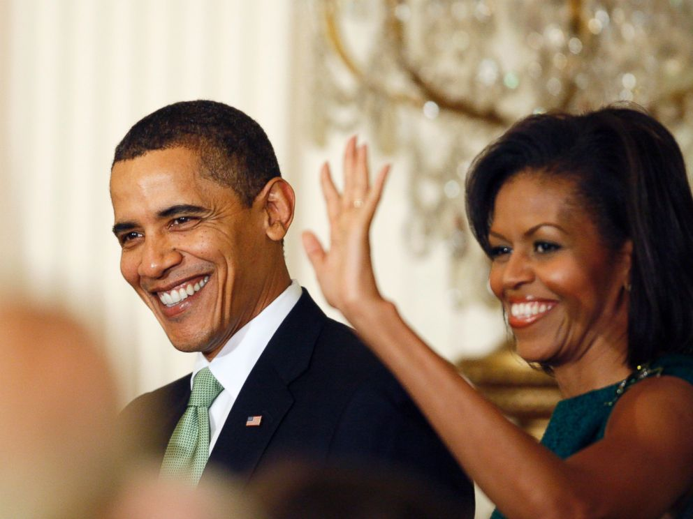 PHOTO: President Barack Obama and Michelle Obama arrive in the East Room of the White House in Washington as they host a St. Patricks Day reception, March 17, 2009.
