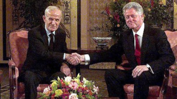 PHOTO: Former US President Bill Clinton (R) meets his Syrian counterpart Hafez al-Assad at the Hotel Intercontinental in Geneva, March 26, 2000.