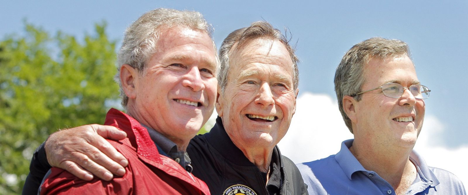 PHOTO: George H.W. Bush is flanked by his sons George W. Bush and Jeb Bush after completing a parachute jump in Kennebunkport on June 12, 2009 for his 85th birthday.