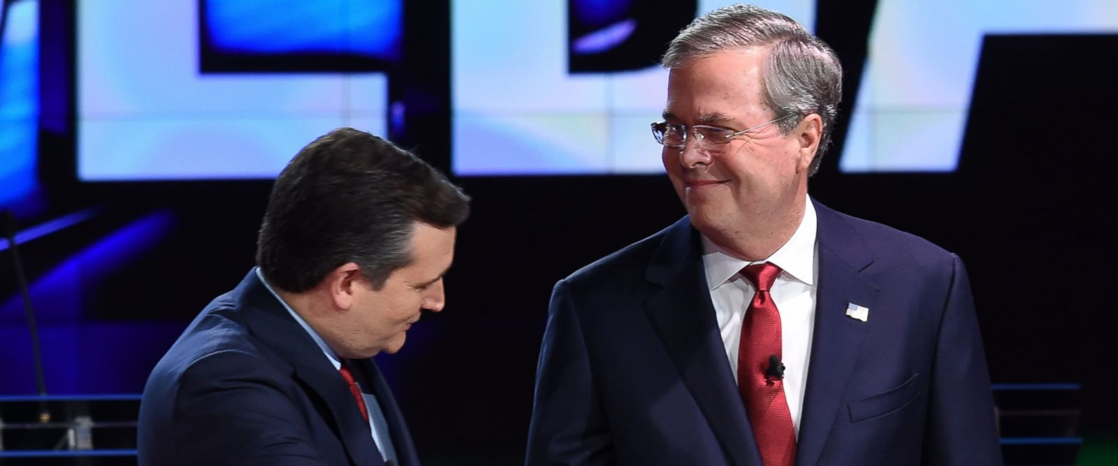 PHOTO: Republican presidential candidate Texas Sen. Ted Cruz (L) shakes hands with former Gov. Florida Jeb Bush on Dec. 15, 2015 at The Venetian Las Vegas in Las Vegas.