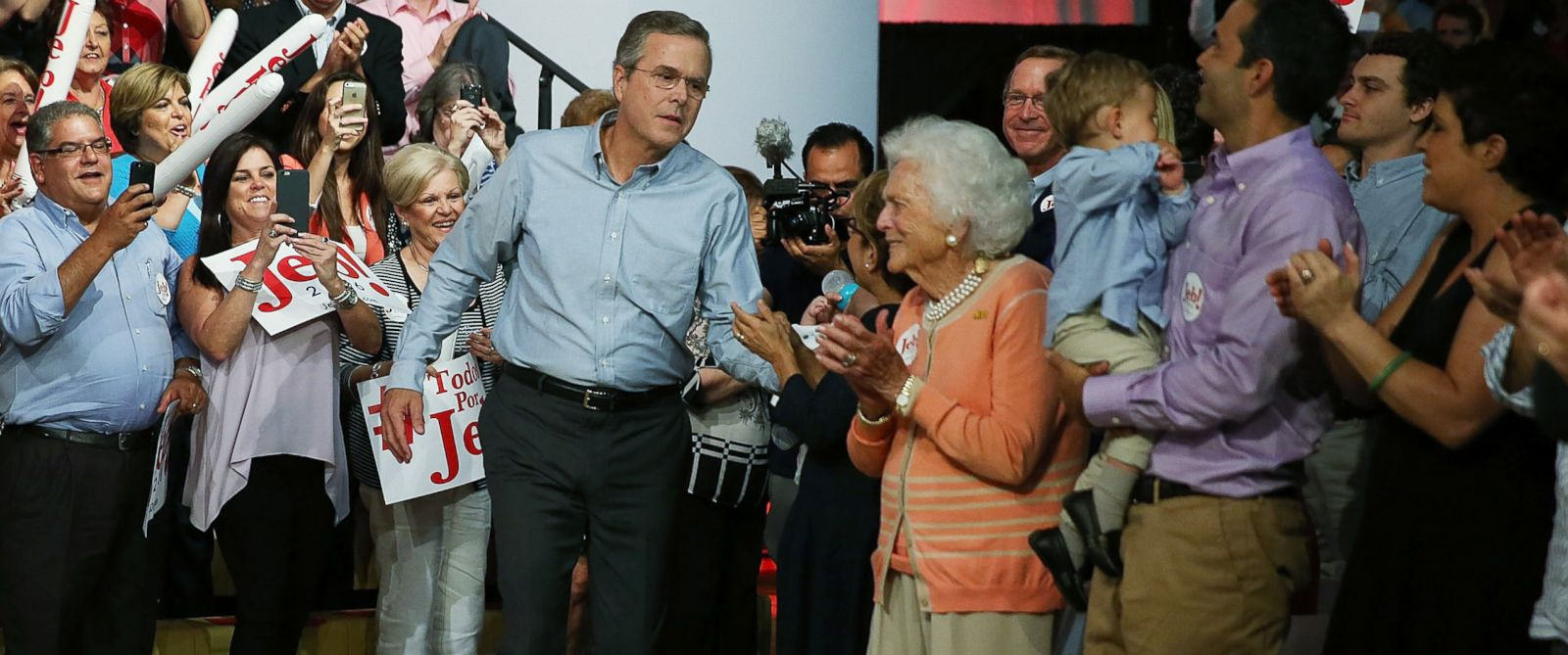 PHOTO: Jeb Bush walks towards his mother Barbara Bush as he prepares to announce his candidacy for the Republican presidential nomination during an event at Miami-Dade College - Kendall Campus on June 15 , 2015 in Miami.
