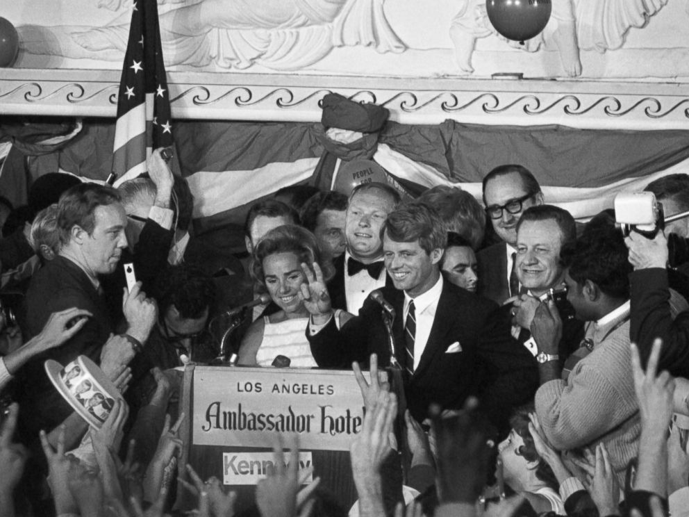 PHOTO: Sen. Robert Kennedy gives a victory sign to a crowd at the Ambassador Hotel June 5, 1968, after winning the California primary. A few minutes later, he was brought down by an assassins bullets upon entering a hotel corridor.