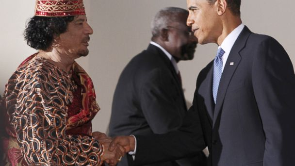 PHOTO: Libyan leader Muammar Gaddafi (L) shakes hands with U.S. President Barack Obama during the G8 summit on July 9, 2009 in LAquila, Italy.