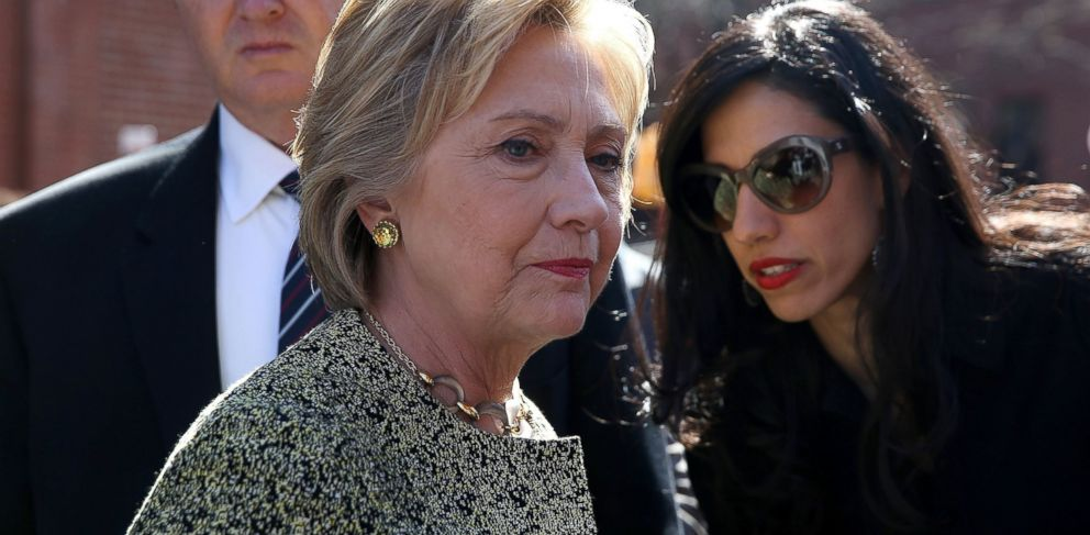 PHOTO: Democratic presidential candidate former Secretary of State Hillary Clinton (L) talks with aide Huma Abedin (R) before speaking at a neighborhood block party, April 17, 2016, New York City.