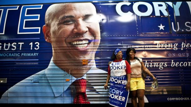 PHOTO: Supporters pose for a picture next to U.S. Senate candidate Cory Bookers campaign