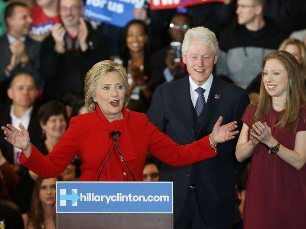 PHOTO: Democratic presidential candidate Hillary Clinton speaks to supporters as former President Bill Clinton and daughter Chelsea Clinton look on during her caucus night event in the Olmsted Center at Drake University, Feb. 1, 2016 in Des Moines, Iowa.