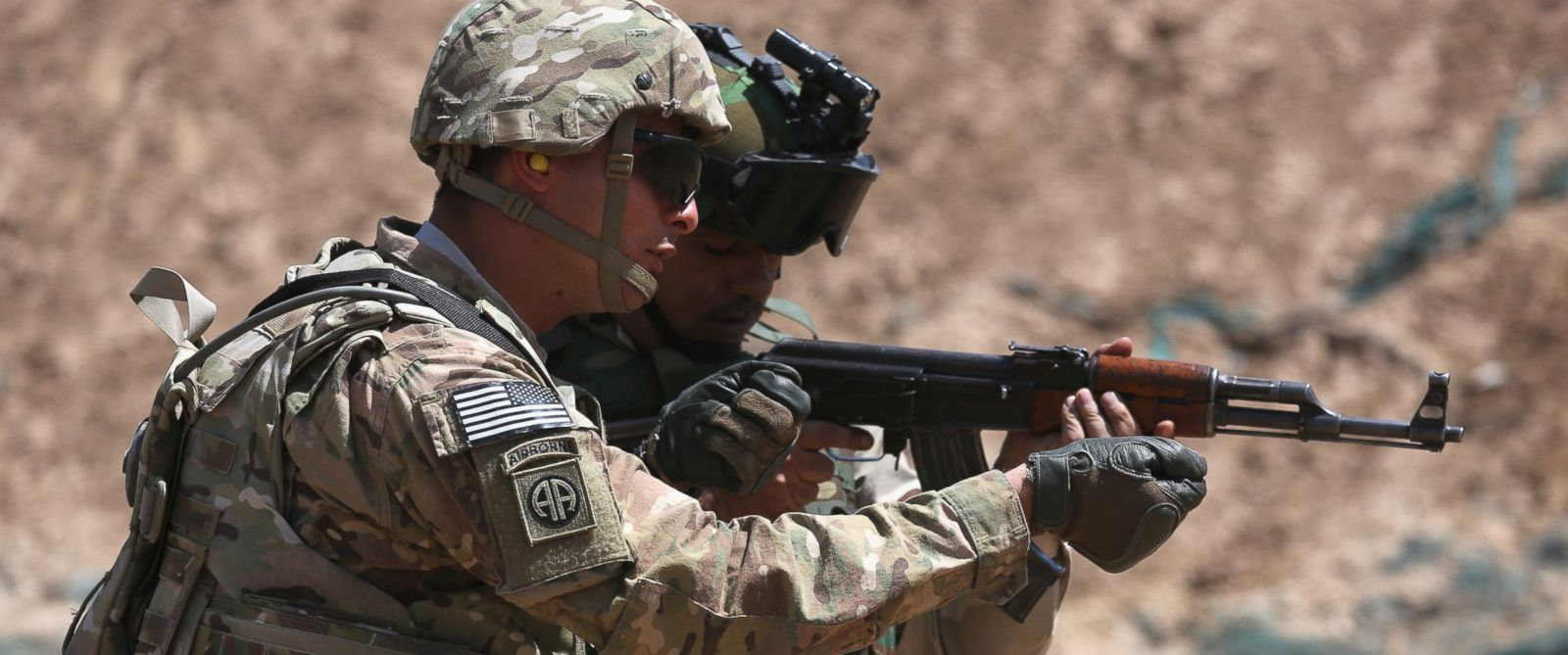 PHOTO: A U.S. Army trainer, left, instructs an Iraqi Army recruit at a military base on April 12, 2015 in Taji, Iraq.