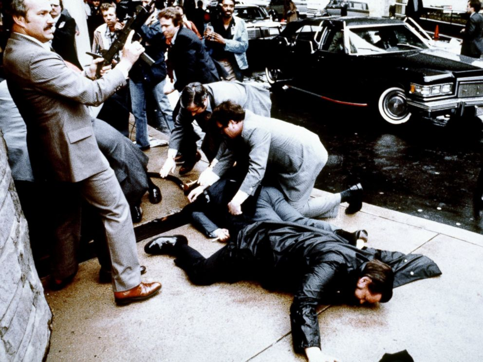 PHOTO: This photo taken by presidential photographer Mike Evens on March 30, 1981 shows police and Secret Service agents reacting during the assassination attempt on then US president Ronald Reagan, after a conference in Washington, D.C.