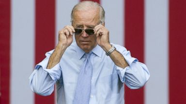 PHOTO: US Vice President Joe Biden takes his sunglasses off as he arrives for a campaign event with President Barack Obama at Strawbery Banke Field in Portsmouth, N.H., Sept. 7, 2012.