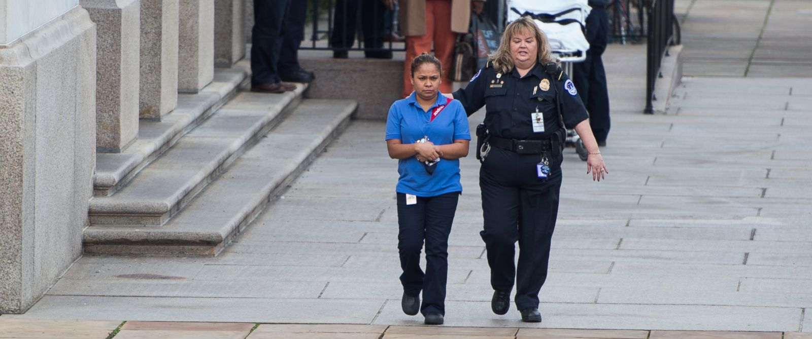 PHOTO: A U.S. Capitol Police officer escorts a Sodexo worker from the Longworth House Office Building after an apparent construction accident left some people in the Longworth cafeteria feeling sick on Jan. 15, 2016.