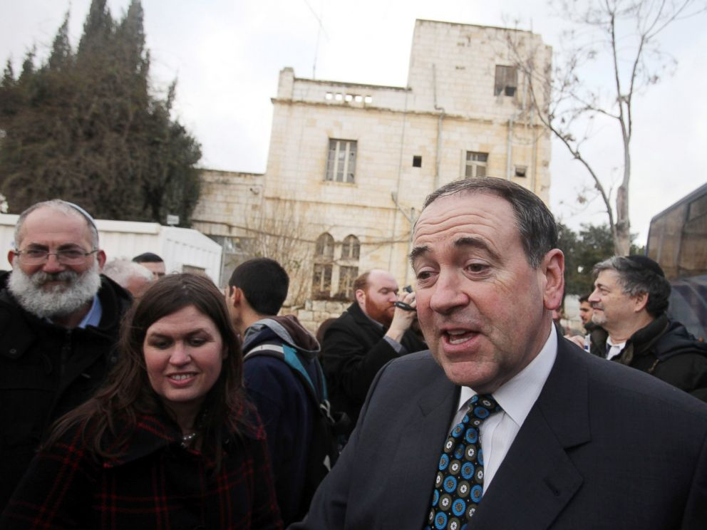 PHOTO: Former Arkansas Gov. and possible Republican presidential candidate Mike Huckabee, right, speaks to the press in front of the Shepherd Hotel, Jan. 31, 2011 in the east Jerusalem neighborhood of Sheikh Jarrah, Israel.