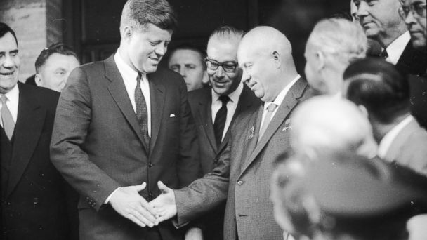 PHOTO: Former Soviet statesman Nikita Khrushchev (right), first secretary of the Soviet Communist Party and former U.S. President John F Kennedy, shake hands at the US Embassy in Vienna.