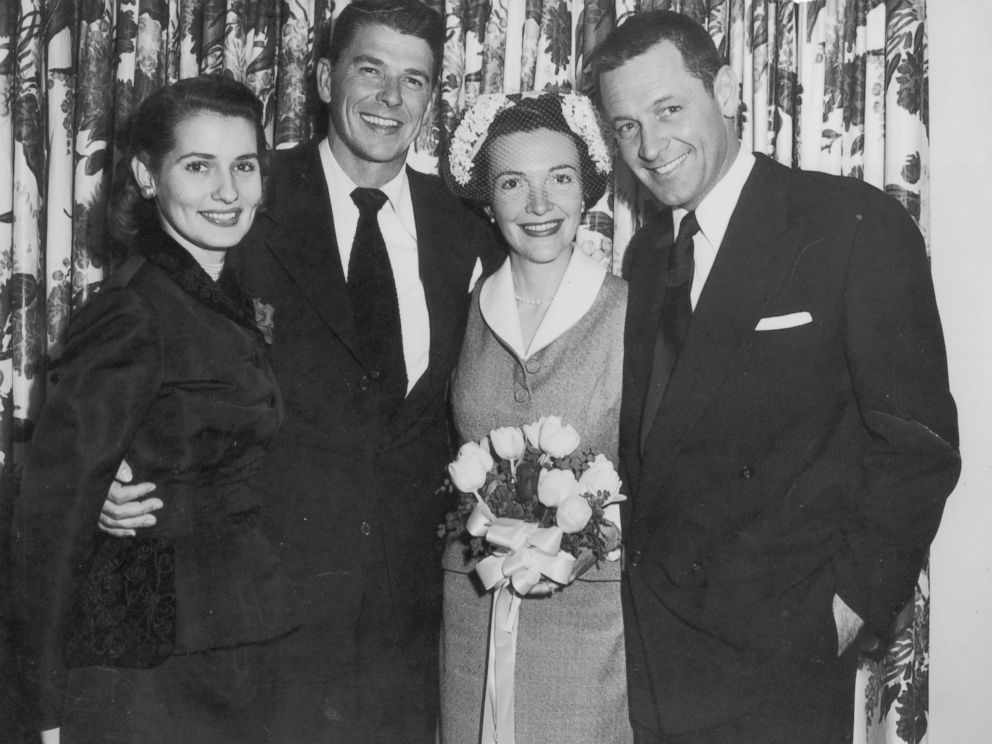 PHOTO: Portrait of American actors Ronald Reagan and Nancy Davis (center) on their wedding day with their arms wrapped around Best Man, American actor William Holden, and Maid of Honor, Phillipine-born actor Brenda Marshall, circa 1952.