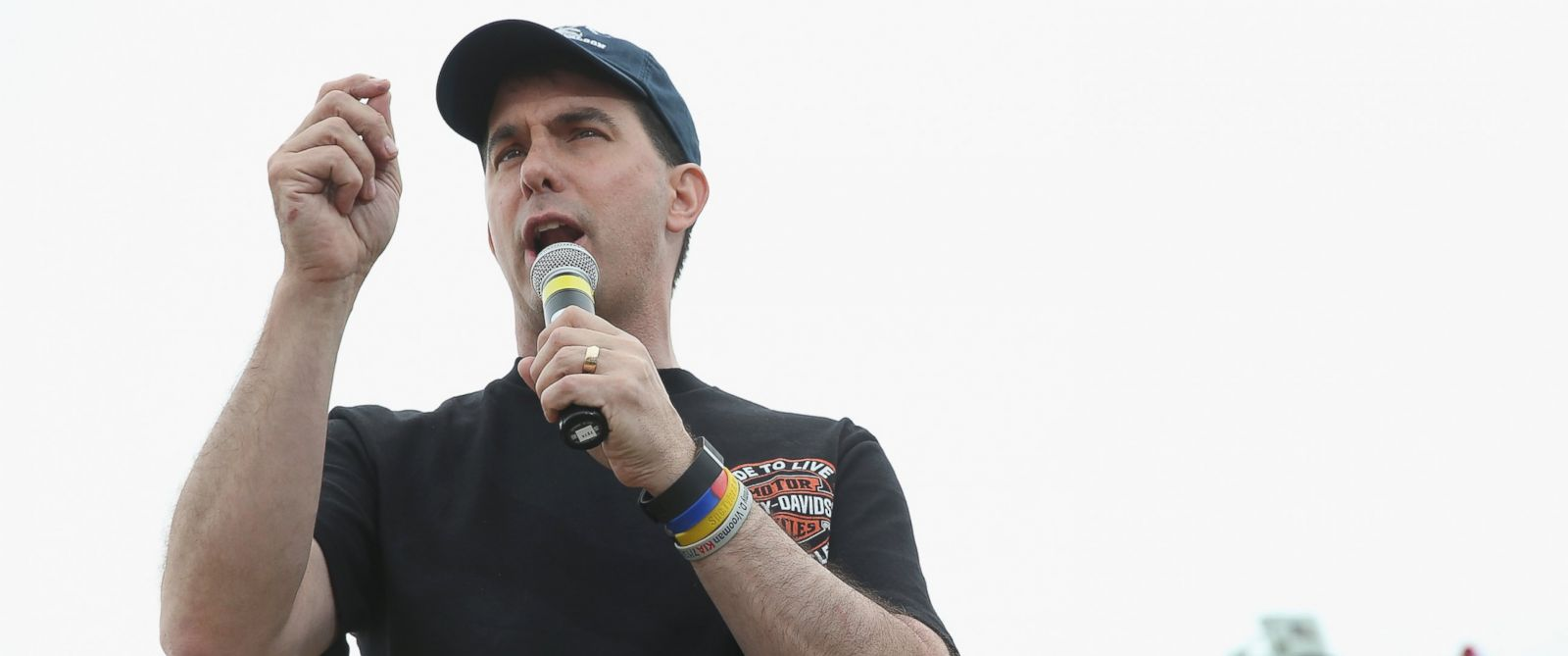 PHOTO: Republican presidential hopeful Wisconsin Governor Scott Walker speaks at a Roast and Ride event hosted by freshman Senator Joni Ernst, R-IA, on June 6, 2015 in Boone, Iowa.