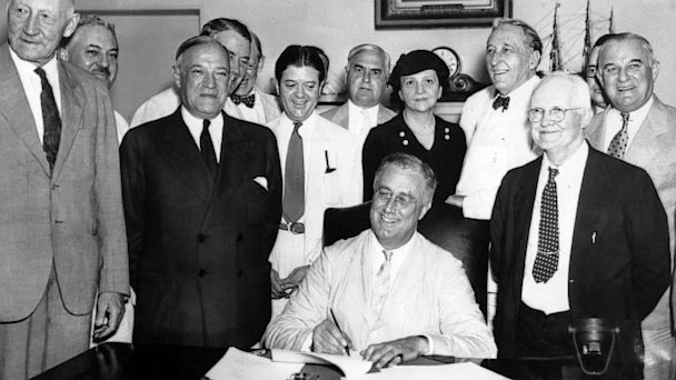 PHOTO: President Franklin D. Roosevelt signs the Social Security Act