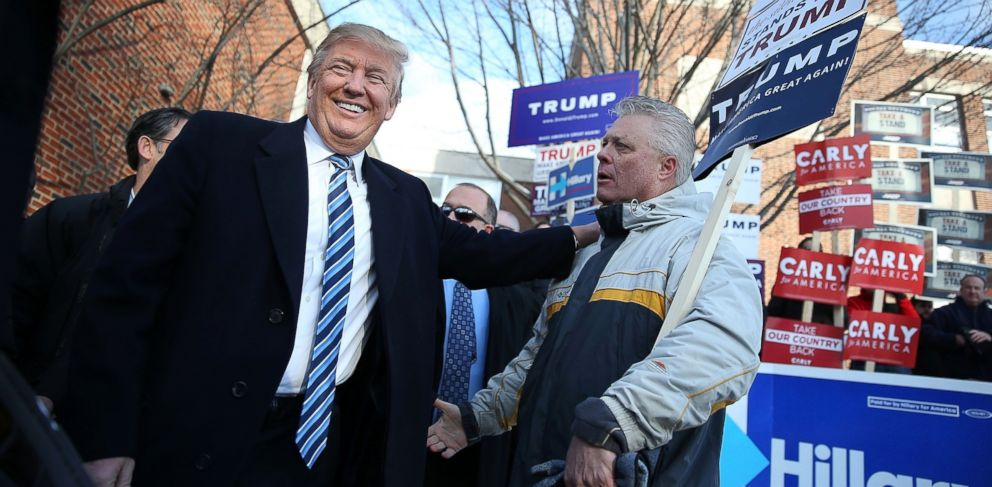 PHOTO: Republican presidential candidate Donald Trump greets people as he visits a polling station as voters cast their primary day ballots, Feb. 9, 2016 in Manchester, N.H.