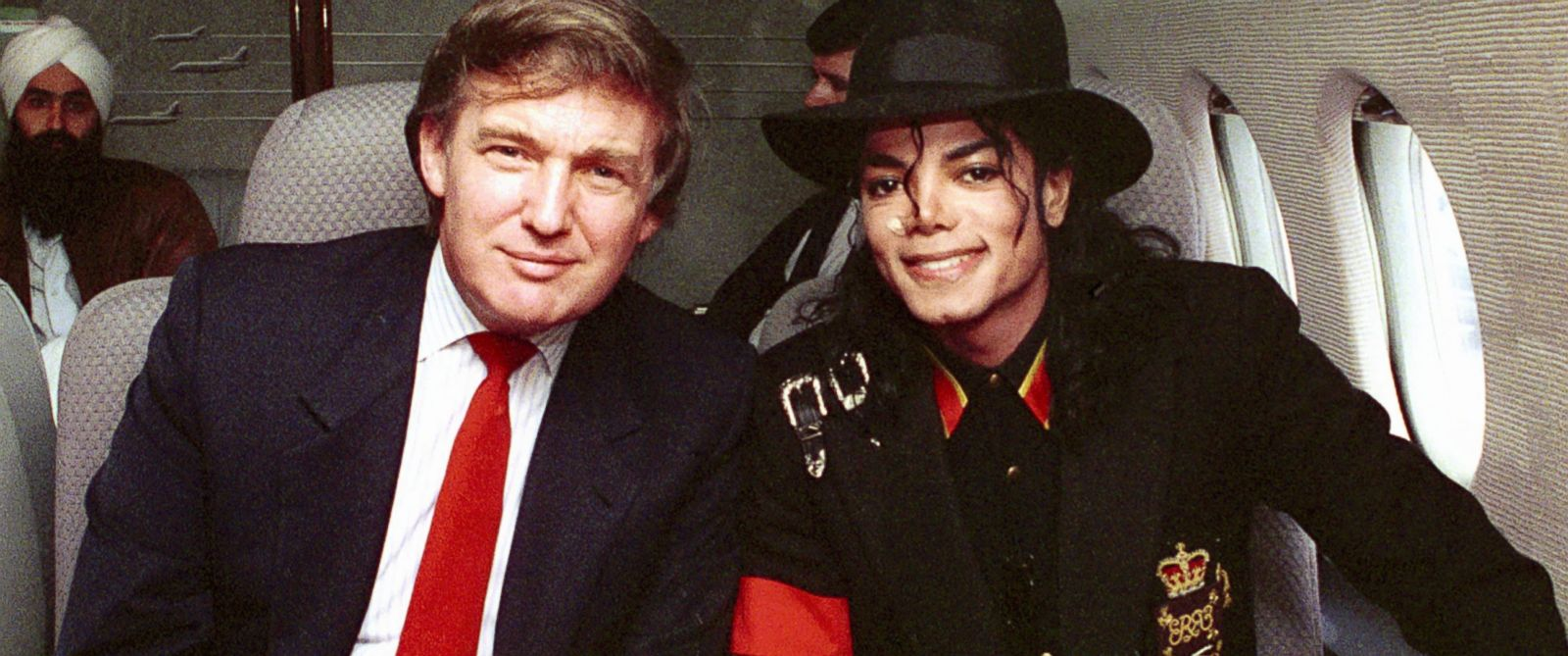 PHOTO: Donald Trump and Michael Jackson, right, are seen onboard a private plane, April 1, 1990.