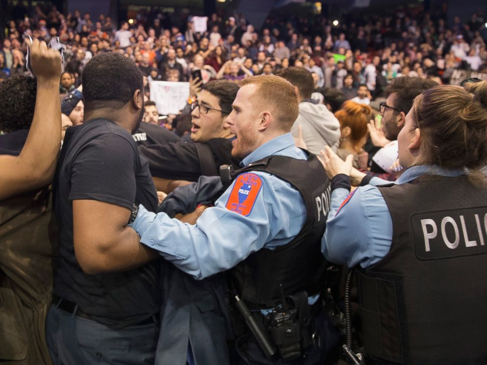 PHOTO: Police break up skirmishes between demonstrators and supporters of Donald Trump that broke out after it was announced a rally at the University of Illinois at Chicago would be postponed, March 11, 2016, in Chicago.