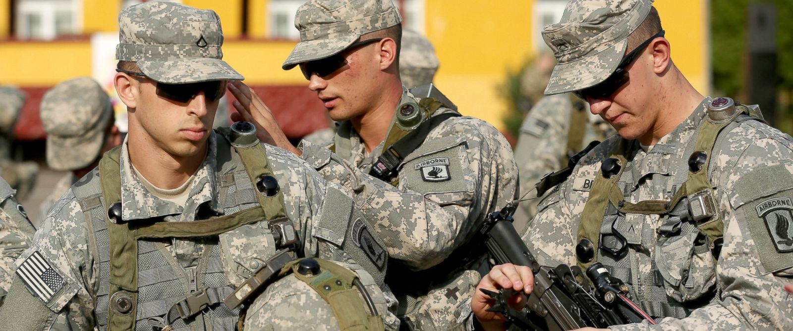 "PHOTO: Members of the U.S. Army 173rd Airborne Brigade prepare weapons and equipment following the opening ceremony of the ""Rapid Trident"" NATO military exercises, Sept. 15, 2014, in this file photo."