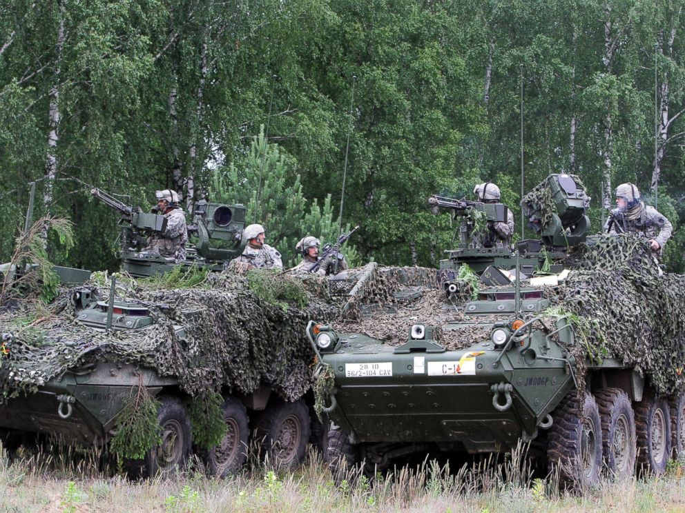 PHOTO: Soldiers from the U.S. Pennsylvania National Guard take part in a field training exercise during the first phase Saber Strike 2014, at the Rukla military base, Lithuania, on June 14, 2014.