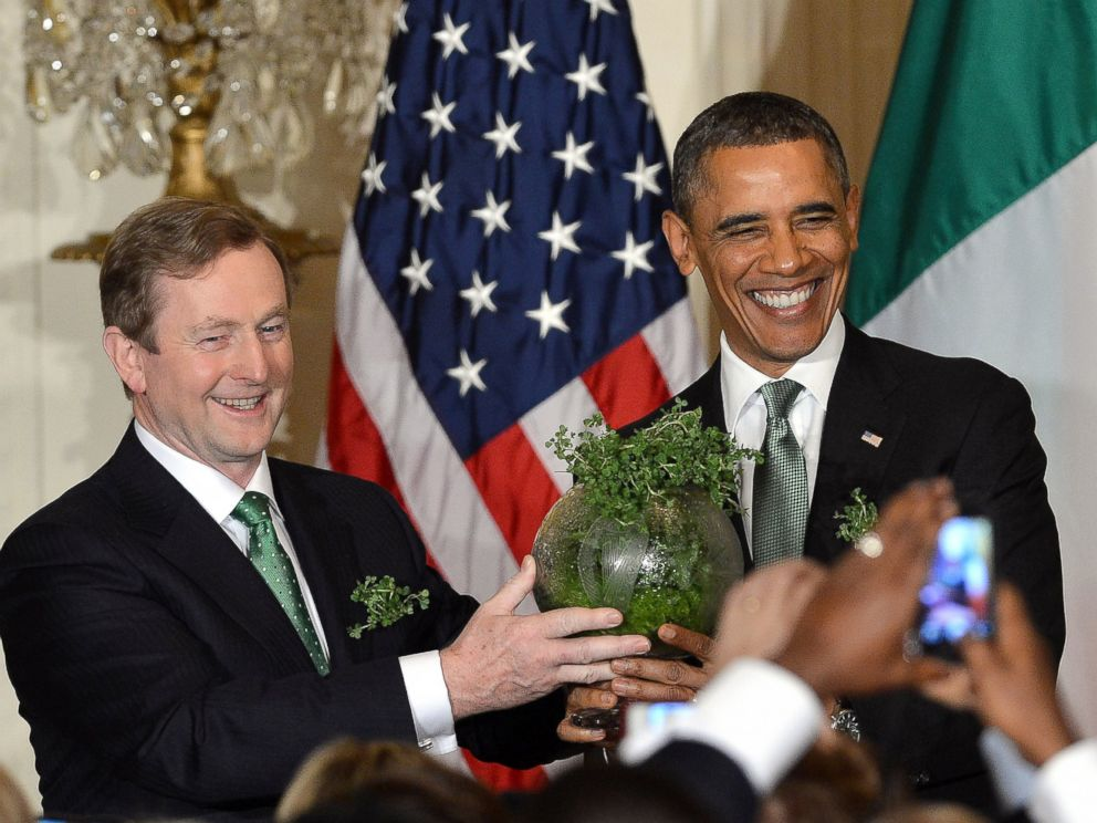 PHOTO: Irish Prime Minister Enda Kenny presents a bowl of shamrock to President Barack during a St. Patricks Day reception in the East Room at the White House in Washington, March 19, 2013.