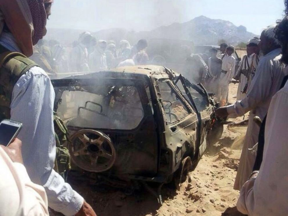 PHOTO: Yemenis gather around a burnt car after it was targeted by a drone strike killing three suspected al-Qaeda militants, Jan. 26, 2015 between the Marib and Chabwa provinces, a desert area east of Sanaa.
