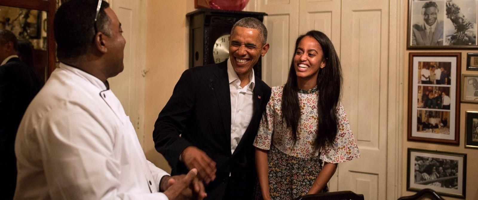PHOTO: President Barack Obama and daughter Malia share a laugh as Malia interprets in Spanish for a restauranteur in Havana, Cuba, Sunday, March 20, 2016.