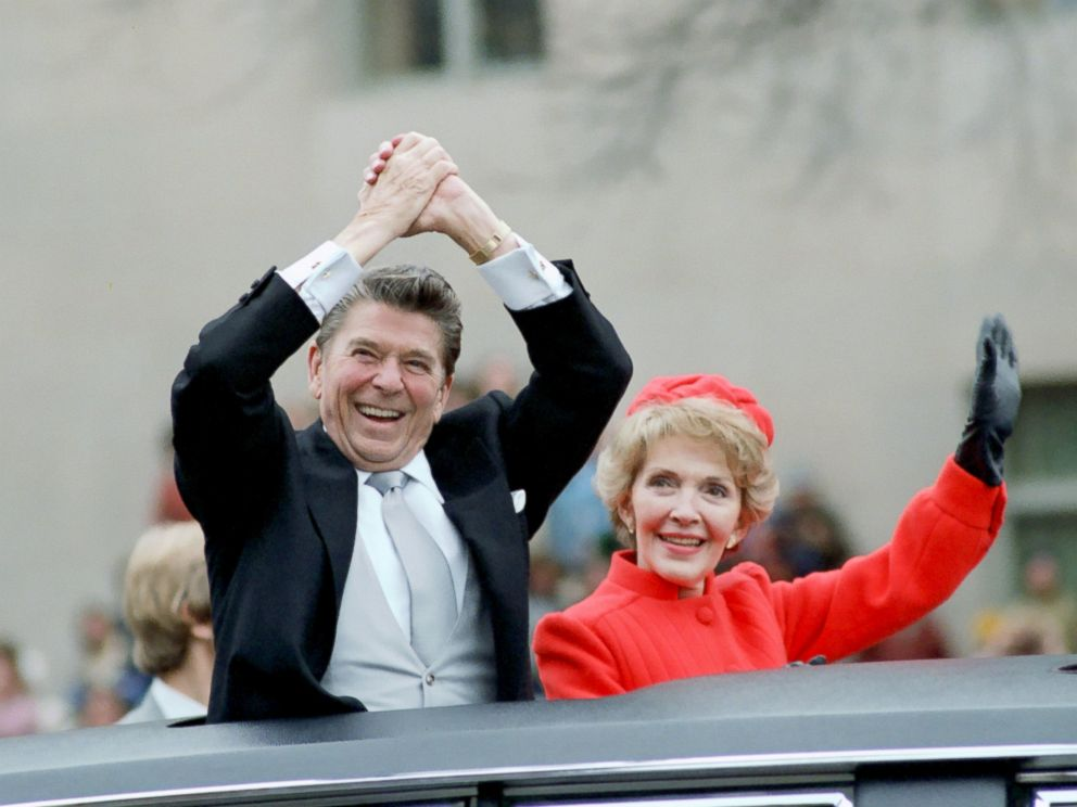 PHOTO: President Reagan and first lady Nancy Reagan wave from the limousine during the Inaugural Parade in Washington, Jan. 20, 1981.