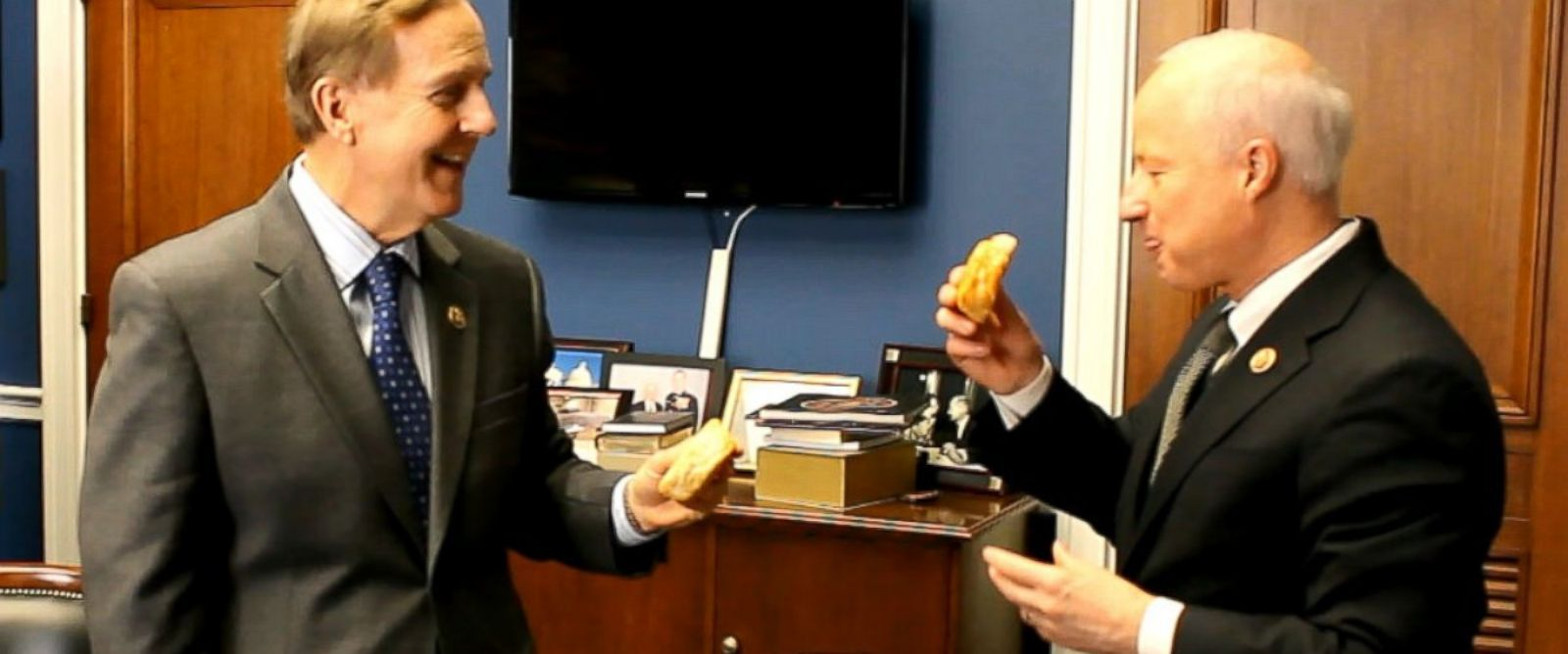 PHOTO: Rep. Robert Pittenger, R-North Carolina, delivers on his Super Bowl wager with Rep. Mike Coffman, R-Coloardo.