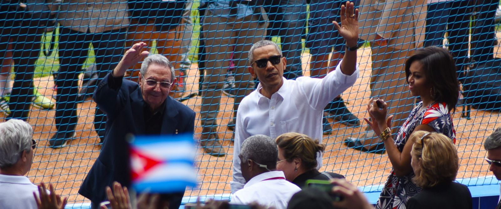 PHOTO:Cuban President Raul Castro and President Barack Obama wave to the crowd as as they attend a exhibition baseball game between the Tampa Bay Rays and the Cuban National team at the Estadio Latinoamericano, March 22, 2016, in Havana.