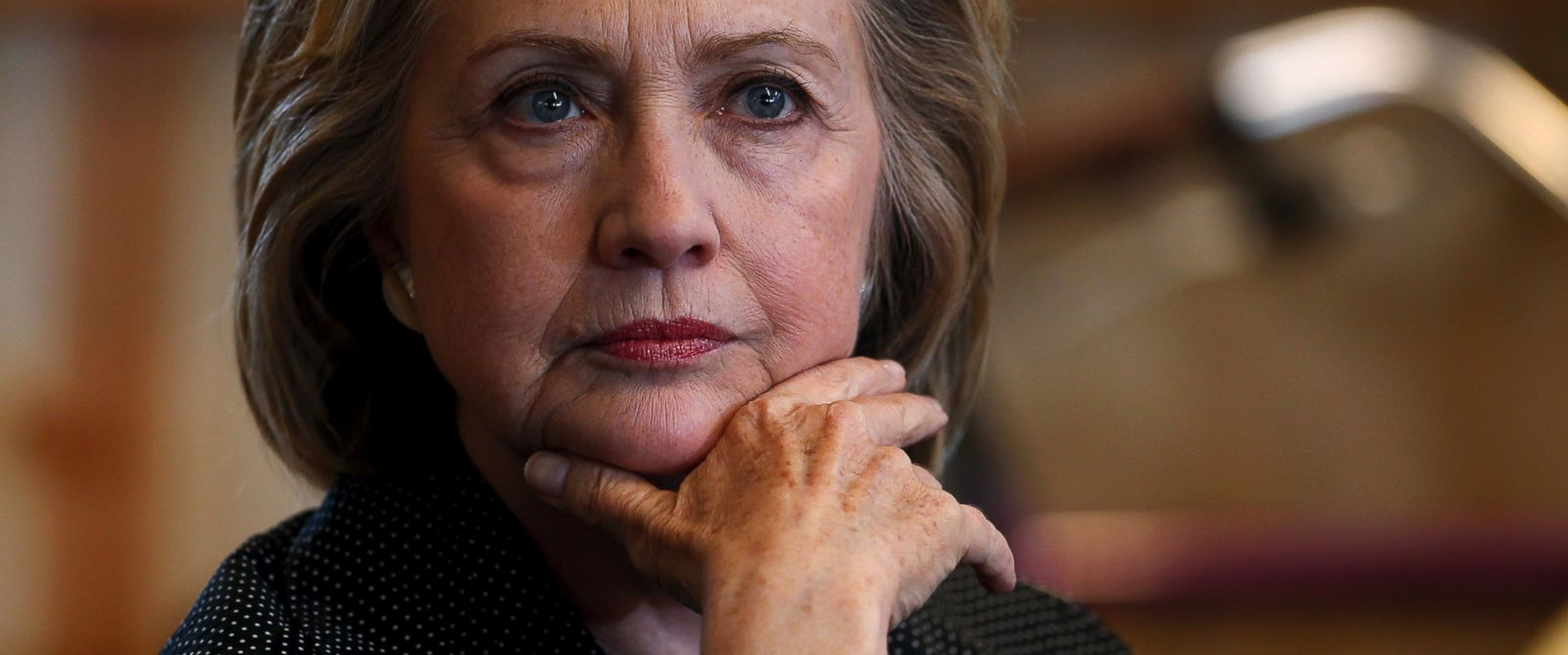 PHOTO: Presidential candidate Hillary Clinton listens to remarks at a roundtable campaign event with small businesses in Cedar Falls, Iowa, May 19, 2015.