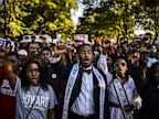 PHOTO: Howard University students participate in the Realize the Dream Rally for the 50th anniversary of the the March on Washington