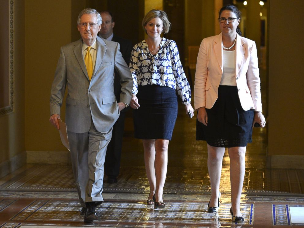 PHOTO: Senate Majority Leader Mitch McConnell, R-KY, left, walks from his office with staff to the floor of the Senate on a rare working Sunday, on Capitol Hill, in Washington, May 31, 2015.