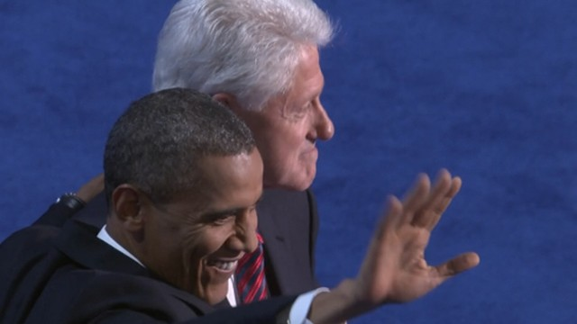 Former and current presidents embrace on stage in front of thousands of DNC delegates.