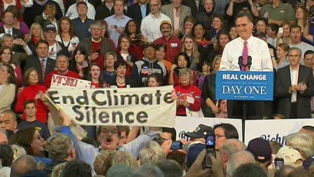 VIDEO: Presidential nominee pauses as protester holding a sign regarding climate change interrupts event.
